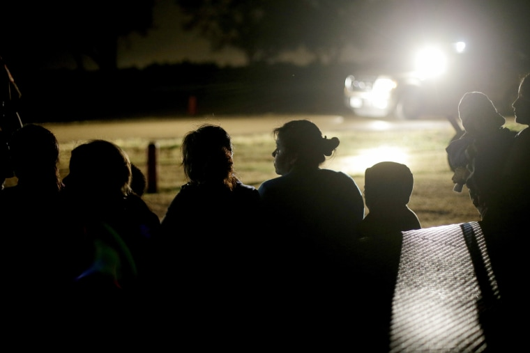 A group of immigrants from Honduras and El Salvador who crossed the U.S.-Mexico border illegally are stopped in Granjeno, Texas on June. 25, 2014.