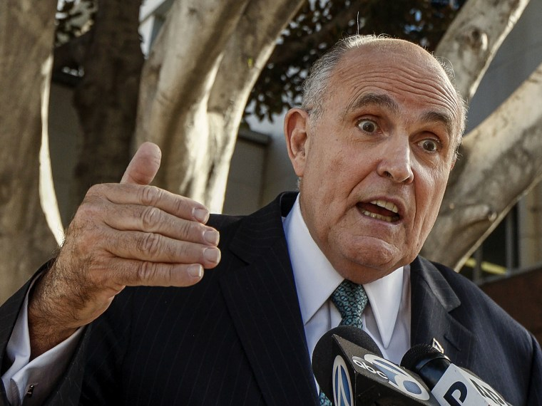 Lawyer and former New York City Mayor Rudy Giuliani comments on a lawsuit filed against video game giant Activision outside Los Angeles Superior court in Los Angeles, Calif., on Oct. 16, 2014. (Photo by Damian Dovarganes/AP)