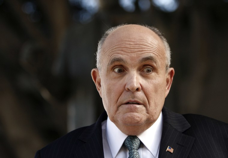 Lawyer and former New York City Mayor Rudy Giuliani at a press conference after appearing in court to call for the dismissal of a lawsuit filed against video game giant Activision in Los Angeles, Calif., Oct. 16, 2014. (Photo by Damian Dovarganes/AP)