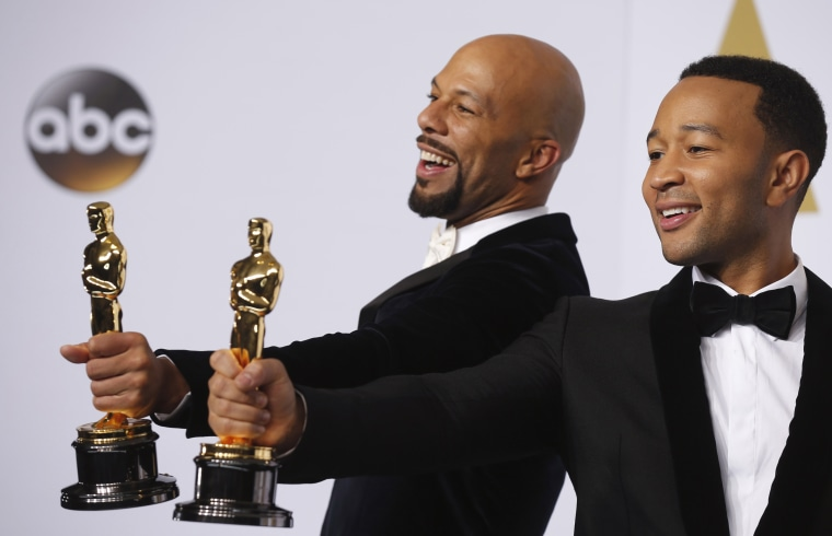 """Singers Common and John Legend take the stage to pose with their Oscars after winning the award for best original song for """"Glory"""" from the film """"Selma"""" during the 87th Academy Awards in Hollywood, Calif., Feb. 22, 2015. (Photo by Lucy Nicholson/Reuters)"""
