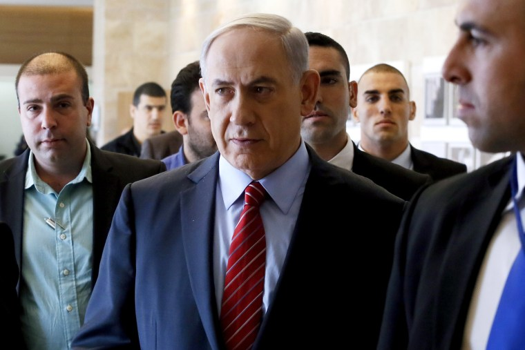 Surrounded by bodyguards, Israeli Prime Minister Benjamin Netanyahu arrives to the Likud faction meeting at the Knesset (Israel's Parliament) on Dec. 3, 2014 in Jerusalem. (Photo by Gali Tibbon/AFP/Getty)