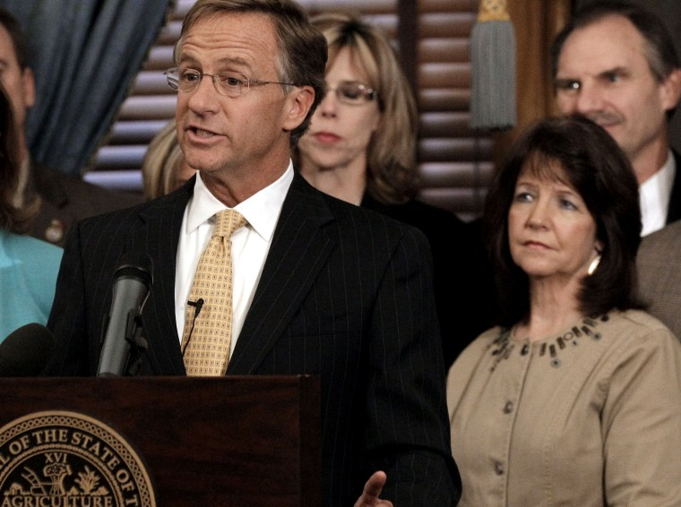 In this Jan. 10, 2012 file photo, Rep. Sheila Butt, lower right, listens as Gov. Bill Haslam talks in Nashville, Tenn. The Tennessee Legislative Black Caucus said Butt should apologize for a Facebook post they say is racist. (Photo by Mark Humphrey/AP)