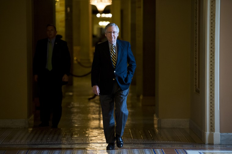 Senate Majority Leader Mitch McConnell, R-Ky., walks to the Senate floor for the votes on funding the Department of Homeland Security on Feb. 27, 2015. (Photo By Bill Clark/CQ Roll Call/AP)