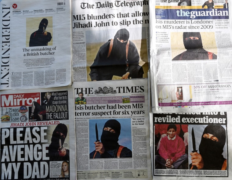 """An arrangement of British daily newspapers photographed in London on Feb. 27, 2015 shows the front-page headlines and stories regarding the identification of the masked Islamic State group militant dubbed \""""Jihadi John\"""". (Photo by Daniel Sorabji/AFP/Getty)"""