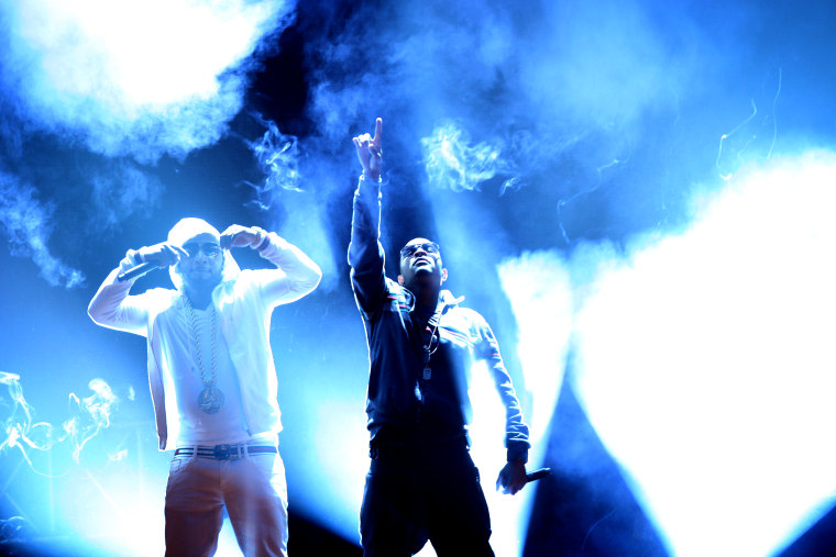 Rapper T.I., center, and Young Jeezy, left, perform during the BET Hip Hop Awards, Oct. 1, 2011 in Atlanta. (Photo by David Goldman/AP)
