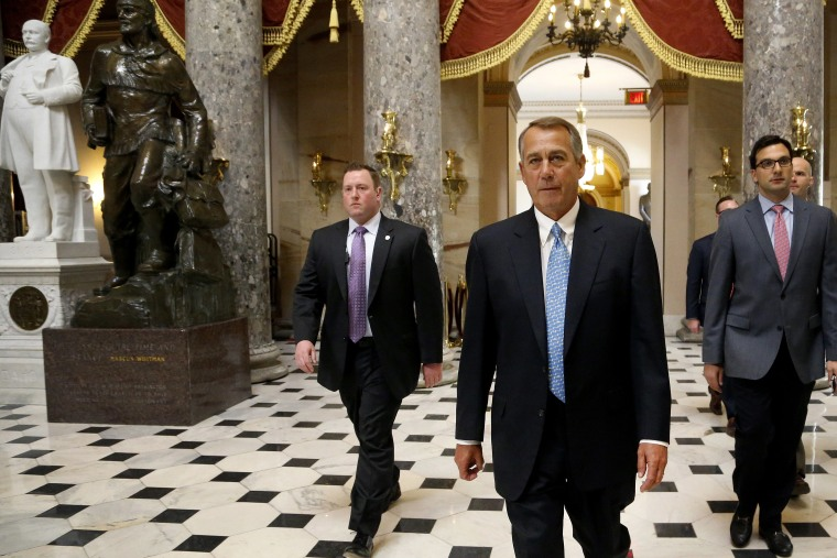 US House Speaker John Boehner returns to his office after a visit to the House floor for procedural votes for legislation to fund the Department of Homeland Security at the Capitol in Washington, Feb. 27, 2015. (Photo by Jonathan Ernst/Reuters)