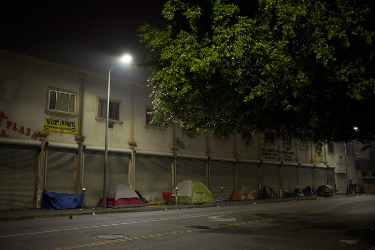 Tents set up by homeless people sit in front of a building on Skid Row, Feb. 4, 2015, in Los Angeles, Calif. (Photo by Jae C. Hong/AP)