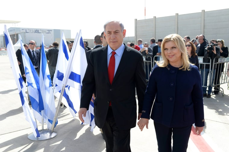 An Israeli government press office handout of Israeli Prime Minister Benjamin Netanyahu with his wife Sarah leaving Tel Aviv, Israel, on March 1, 2015 on their way to Washington D.C. (Photo by Amos Ben Gershom/GPO/EPA)