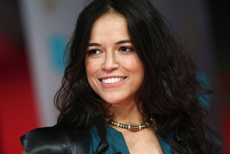 Actress Michelle Rodriguez arrives on the red carpet for the BAFTA British Academy Film Awards at the Royal Opera House in London on Feb. 16, 2014. (Photo by Andrew Cowie/AFP/Getty)