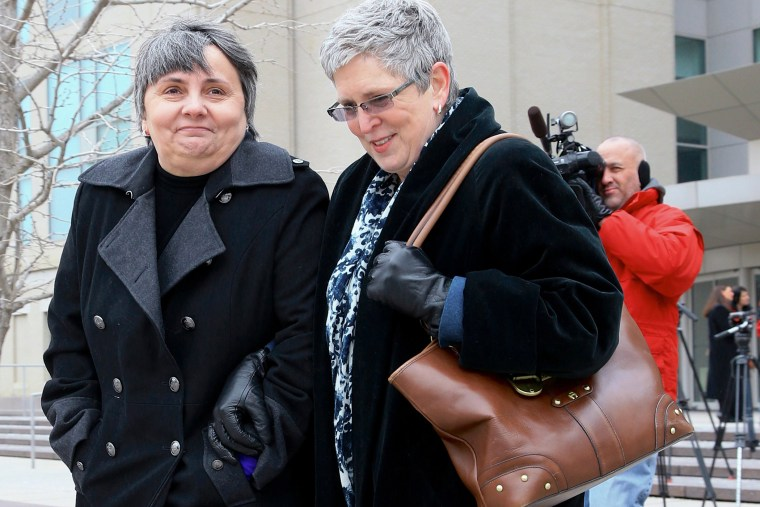 Susan Waters, left, and Sally Waters walk away from Federal Court in Omaha, Neb., after a hearing, Feb. 19, 2015. (Photo by Nati Harnik/AP)