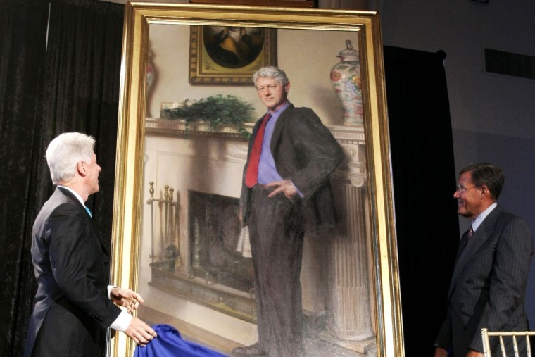 Former President Bill Clinton, left, looks up at his portrait after Lawrence M. Small, secretary of the Smithsonian Institution, right, helped him remove the drape, April 24, 2006, in Washington, D.C. (Photo by Haraz N. Ghanbari/AP)