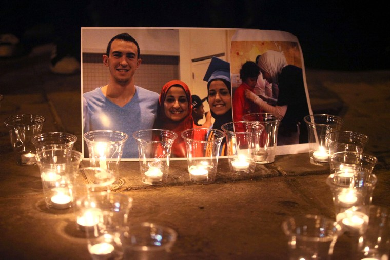Candles are seen as a group of demonstrators gather in front of American Embassy in Amman to protest against the Chapel Hill shooting, in Amman, Jordan on Feb. 16, 2015. (Photo by Shadi Nsoor/Anadolu Agency/Getty)