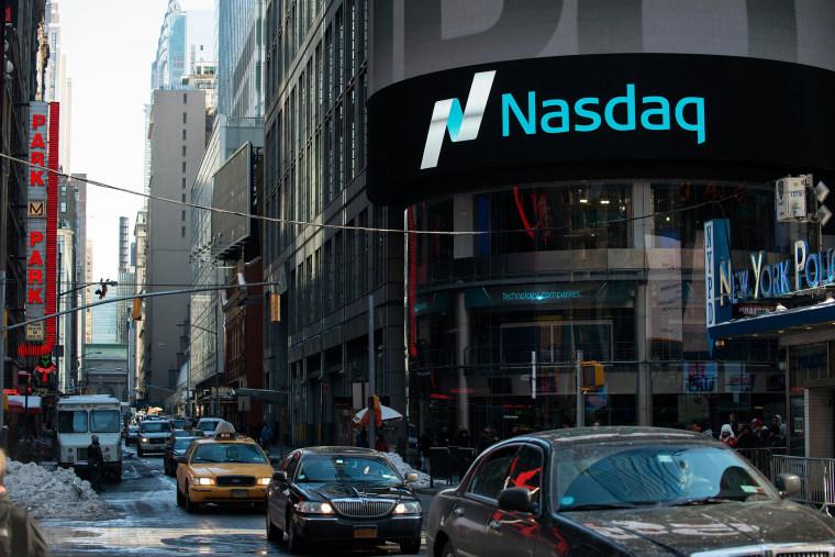 Cars drive past the NASDAQ MarketSite on March 2, 2015 in New York City.