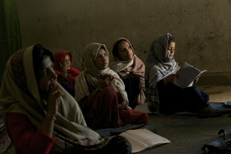 A group of conflict displaced Bajauri girls sit in a class in a UNICEF supported school in Risalpur, Pakistan in 2011.
