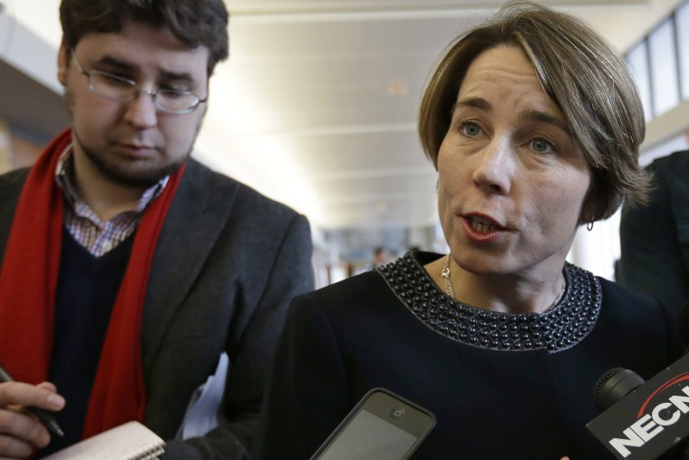 Massachusetts Attorney General Maura Healey, center, speaks with members of the media on Jan. 22, 2015, in Boston.