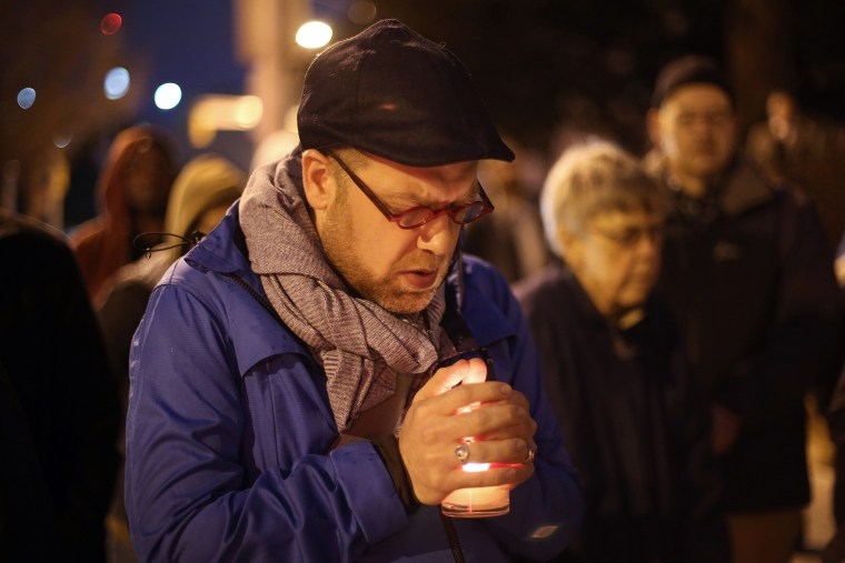 Michael Patter, senior minister at Central Congregational United Church of Christ, prays silently during a vigil for Kelly Gissendaner and protest against the death penalty on March 2, 2015, on the steps of the State Capitol.