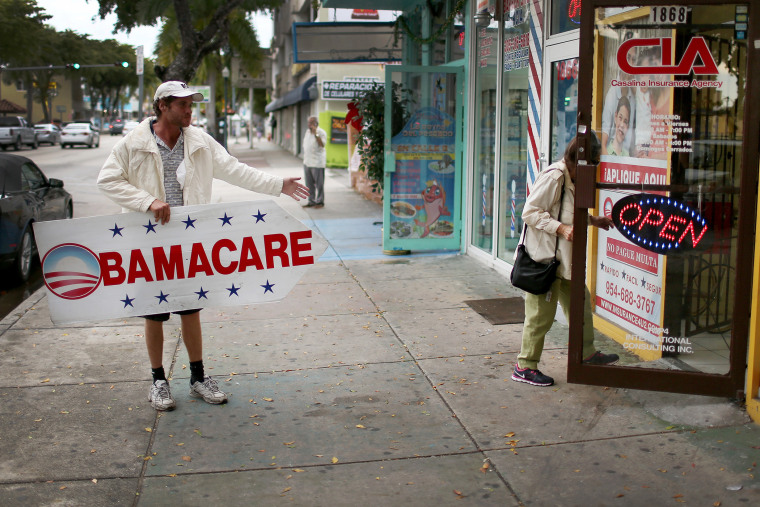 Pedro Rojas holds a sign directing people to an insurance company where they can sign up for the Affordable Care Act, also known as Obamacare, before the February 15th deadline on Feb. 5, 2015 in Miami, Fla.