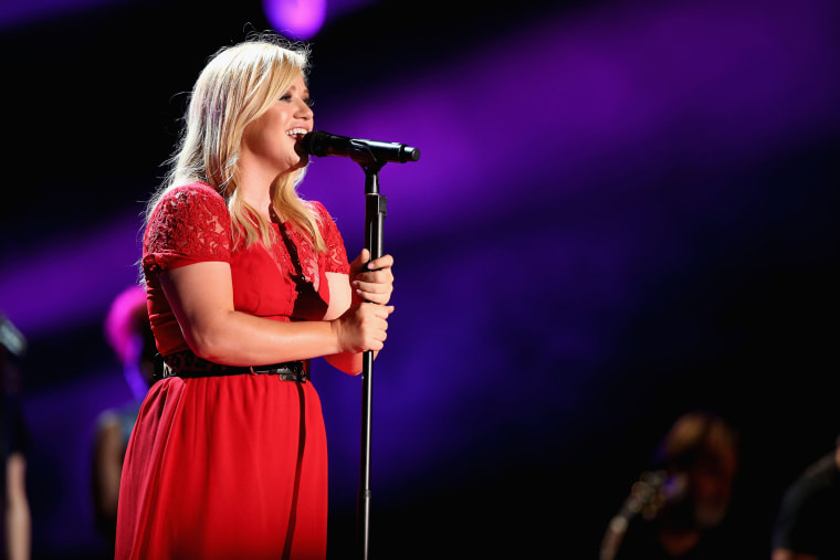 Singer Kelly Clarkson performs during the 2013 CMA Music Festival on June 8, 2013 at LP Field in Nashville, Tenn. (Photo by Christopher Polk/Getty)