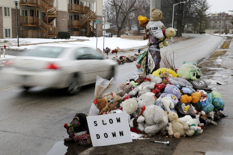 A car passes a memorial for Michael Brown, who was shot and killed by Ferguson, Mo., Police Officer Darren Wilson last summer, on March 3, 2015, in Ferguson.