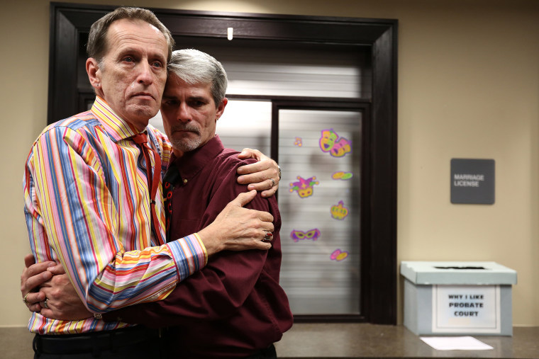 Robert Povilat, left, and Milton Persinger, comfort each other after hearing that for a second day, the Mobile County Probate office won't issue marriage licenses on Feb. 10, 2015 in Mobile, Ala.