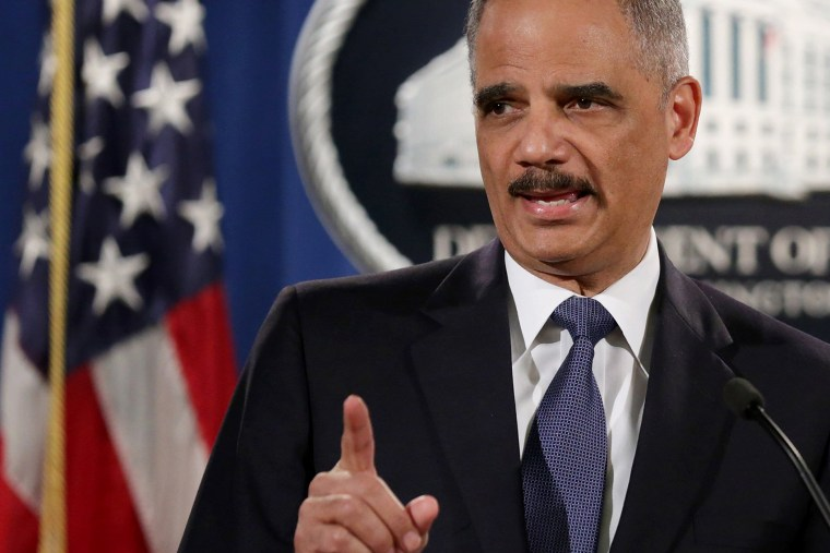 Attorney General Eric Holder delivers remarks about the Justice Department's findings related to two investigations in Ferguson, Mo. at the Robert F. Kennedy Department of Justice Building on March 4, 2015 in Washington, DC.