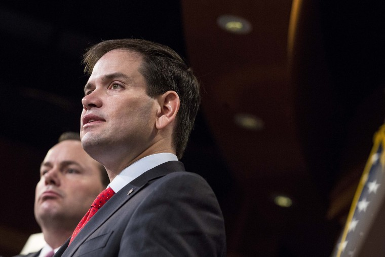 Sen. Marco Rubio (R-FL) speaks next to Sen. Mike Lee (R-Utah) during a news conference to introduce their proposal for an overhaul of the tax code, March 4, 2015 on Capitol Hill in Washington, DC. (Photo by Drew Angerer/Getty)
