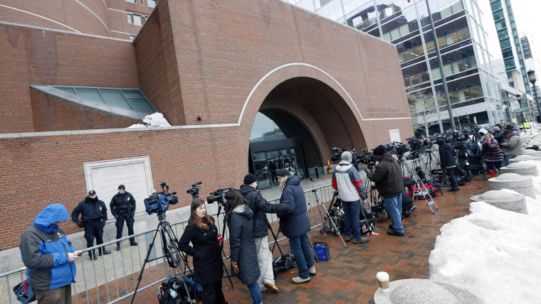 Members of the media wait outside federal court, Wednesday, March 4, 2015, in Boston, on the first day of the federal death penalty trial of Boston Marathon bombing suspect Dzhokhar Tsarnaev