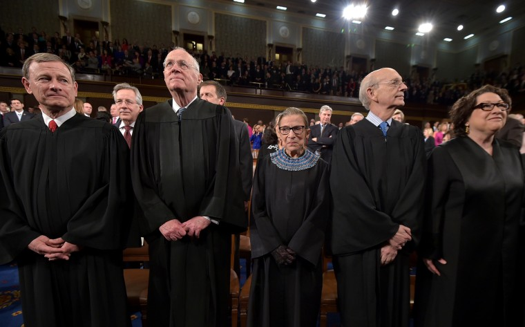 US Supreme Court Justices (L-R) John G. Roberts, Anthony M. Kennedy, Ruth Bader Ginsburg, Stephen G. Breyer and Sonia Sotomayor stand before the State of the Union address on Jan. 20, 2015 in Washington, DC. (Photo by Mandel Ngan-Pool/Getty)