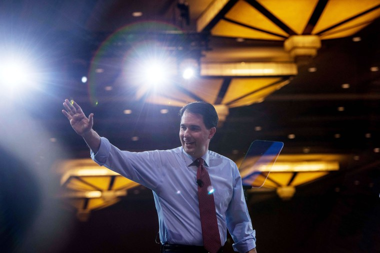 Wisconsin Governor Scott Walker walks off stage after speaking at the annual Conservative Political Action Conference (CPAC) at National Harbor, Maryland, outside Washington, on Feb. 26, 2015