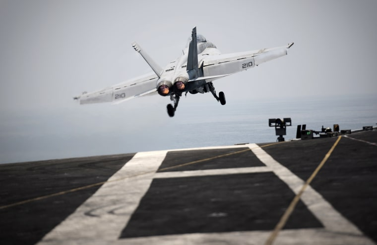 An F/A-18C hornet takes off for Iraq from the flight deck of the US navy aircraft carrier USS George H.W. Bush on Aug. 15, 2014 in the Gulf. (Photo by Mohammed Al-Shaikh/AFP/Getty)
