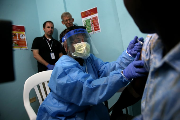 A nurse administers an injection to Emmanuel Lansana, 43, the first person to take part in the Ebola vaccine trials being conducted at Redemption Hospital, formerly an Ebola holding center, on Feb. 2, 2015 in Monrovia, Liberia. (Photo by John Moore/Getty)