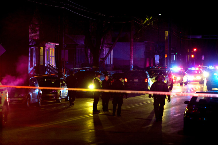 Madison Police investigate the scene of a shooting on Williamson Street on March 6, 2015 in Madison, Wis. (Photo by Steve Apps/Wisconsin State Journal/AP)