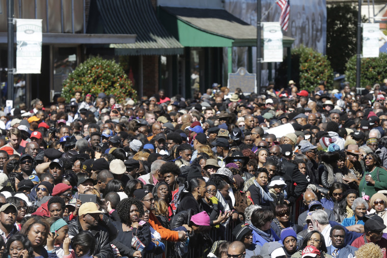A large crowd forms near a stage where President Barack Obama will speak and then take a symbolic walk across the Edmund Pettus Bridge on March 7, 2015, in Selma, Ala. (Photo by Gerald Herbert/AP)