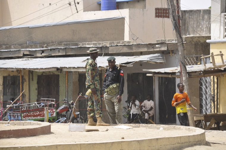 Security forces stand guard at the site of bomb explosion at a market in Maiduguri, Nigeria on March 7, 2015. (Photo by Jossy Ola/AP)
