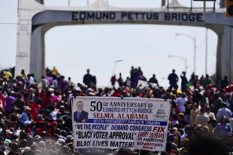 Crowds take a symbolic walk across the Edmund Pettus Bridge on March 8, 2015, in Selma, Ala. (Photo by Bill Frakes/AP)