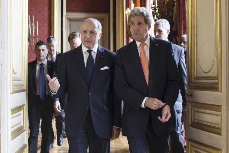 French Foreign Affairs Minister Laurent Fabius (L) and U.S. Secretary of State John Kerry speak as they arrive for a meeting at the French Foreign Affairs Ministry in Paris on March 7, 2015. (Photo by Etienne Laurent/Pool/Reuters)