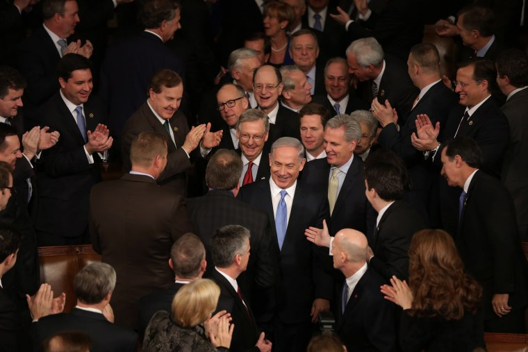 Israeli Prime Minister Benjamin Netanyahu is greeted by members of Congress as he arrives to speak during a joint meeting of the United States Congress at the Capitol March 3, 2015 in Washington, DC. (Photo by Chip Somodevilla/Getty)