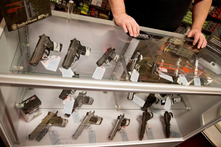 Customers shop for a handgun at Metro Shooting Supplies on Nov. 12, 2014 in Bridgeton, Mo. (Photo by Scott Olson/Getty)