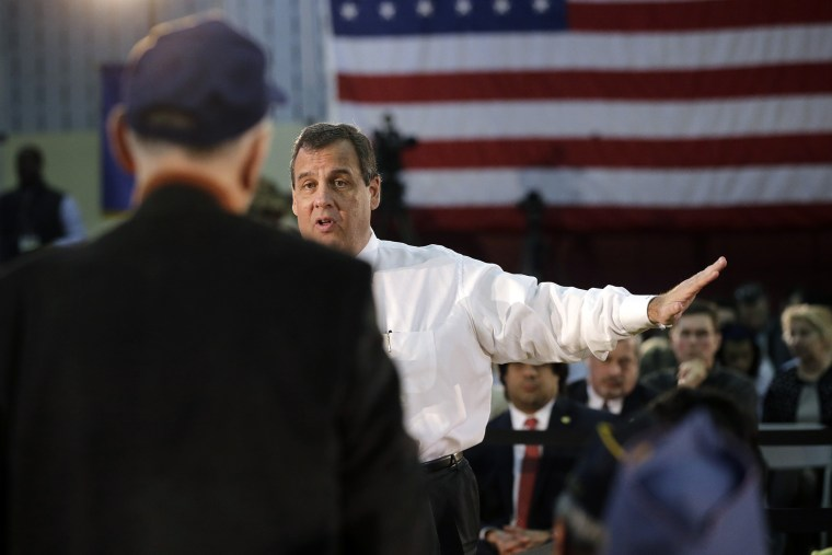 New Jersey Gov. Chris Christie answers a question from Dr. Eugene Yuliano during a town hall meeting Tuesday, March 10, 2015, in Somerville, N.J.