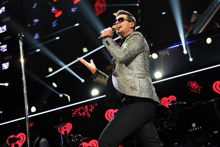 This Dec. 13, 2013 file photo shows Robin Thicke performing at Madison Square Garden in New York, N.Y. (Photo by Evan Agostini/Invision/AP)