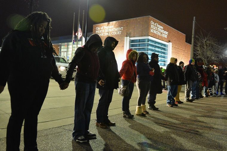 Protestors demonstrate outside the Ferguson Police Department in Ferguson, Missouri on March 4, 2015. (Photo by Michael B. Thomas/Getty)