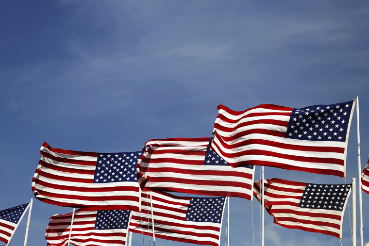 American flags flap in the wind. (Photo by Larry Downing/Reuters)