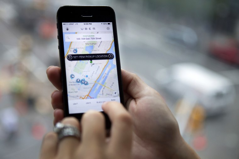 Th Uber Technologies Inc. car service application is demonstrated for a photograph on an iPhone in New York, N.Y., on Aug. 6, 2014. (Photo by Victor J. Blue/Bloomberg/Getty)