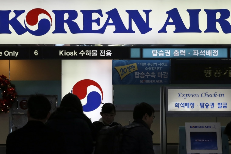 In this Dec. 16, 2014 photo, passengers wait to check in at the domestic check-in desk of Korean Air Lines Co. at Gimpo Airport in Seoul, South Korea. (Photo by Lee Jin-man/AP)