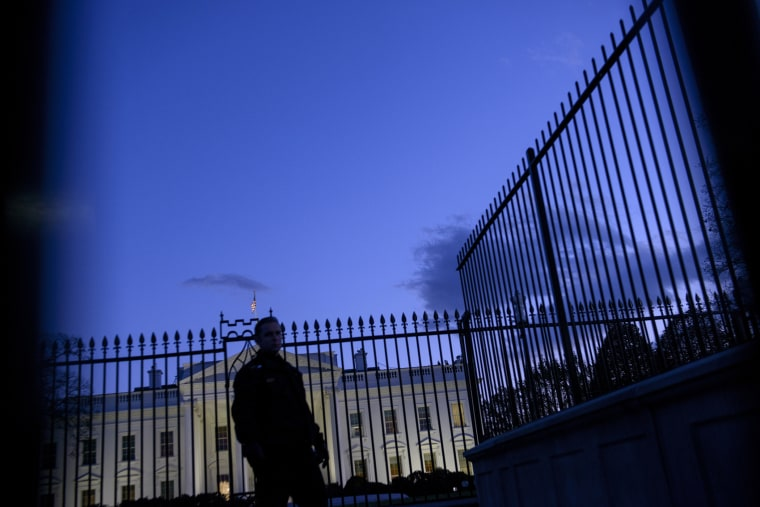 A member of the Secret Service's uniformed division stands by a fence in front of the White House on Nov. 20, 2014 in Washington, DC. (Photo by Brendan Smialowski/AFP/Getty)