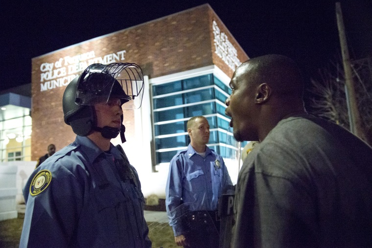 A protester confronts a police officer outside the City of Ferguson Police Department and Municipal Court in Ferguson, Missouri, March 11, 2015. (Photo by Kate Munsch/Reuters)