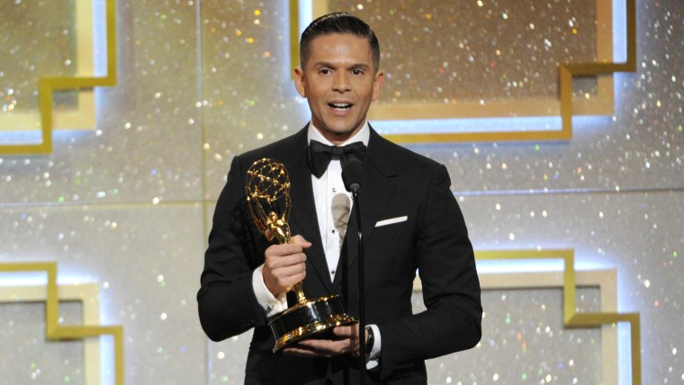 """Rodner Figueroa accepts the award for outstanding daytime talent in Spanish for \""""El Gordo y la Flaca\""""€ at the 41st annual Daytime Emmy Awards at the Beverly Hilton Hotel on June 22, 2014, in Beverly Hills, Calif. (Photo by Chris Pizzello/Invision/AP)"""