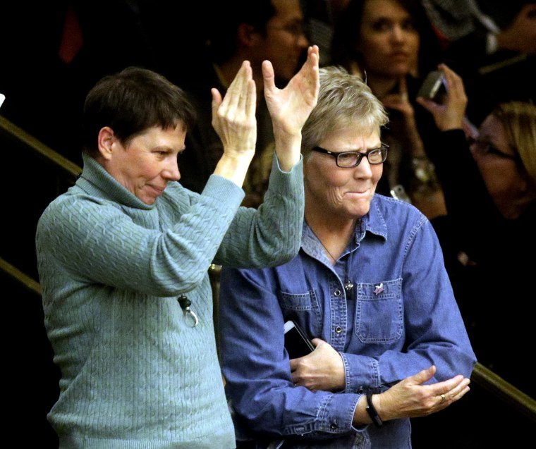Kody Partridge, left, and her wife, Laurie Wood celebrate after the Republican-controlled Utah Legislature passes a anti-discrimination bill, March 11, 2015, in Salt Lake City. (Photo by Rick Bowmer/AP)
