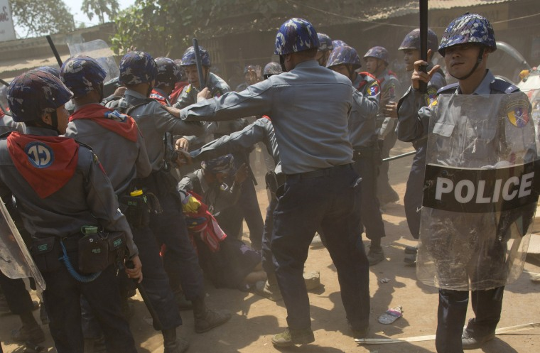Police officers beat a student protester lying on the ground following a crackdown in Letpadan, about 90 miles north of Yangon, the capitol of Myanmar on March 10, 2015.