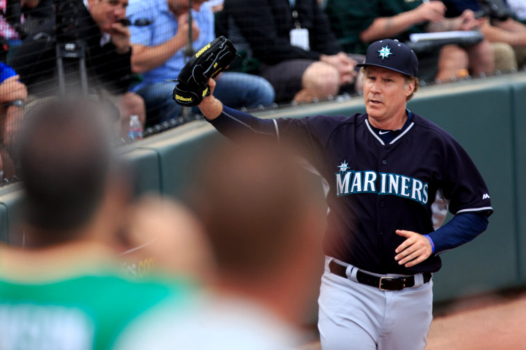 Will Ferrell waves to fans as he leaves the field after playing infield for the Seattle Mariners a spring training game against the Oakland Athletics at HoHoKam Stadium in Mesa, Ariz. on March 12, 2015.